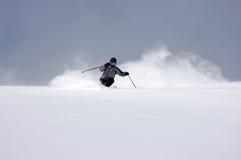 Powder skiing. Skier in fresh Utah powder Royalty Free Stock Photography