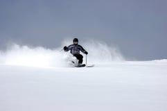 Powder skiing. Skier in fresh Utah powder Royalty Free Stock Image
