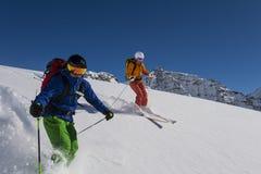 Powder skiing with airbag. Airbag save lives - alpine skiing Stock Photo