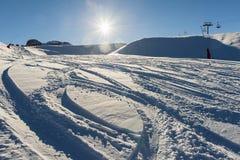 Powder snow piste in alpine ski resort Royalty Free Stock Photo