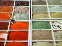 Powder spices colorful assortment in wooden boxes on a market shelf stand stock photo