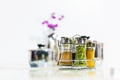 Powder spices in glass bottle jar Stock Photo