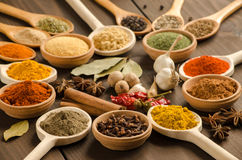 Powder spices on mixing spoons at wooden table Stock Photography