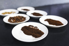 Powdered coffee on white china dishes. Coffee powder on white china dishes stock images