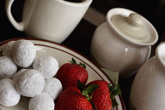 Powdered donuts and strawberries Royalty Free Stock Photography