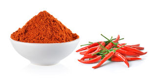 Powdered dried red pepper and red chili peppers in a white bowl Stock Photos