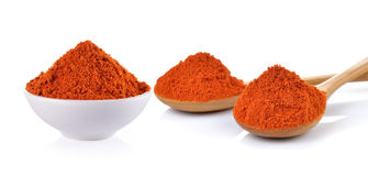 Powdered dried red pepper in a white bowl and wood spoon on whit Royalty Free Stock Image