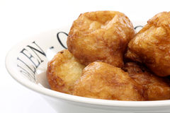 Powdered Dutch oliebollen Royalty Free Stock Photo