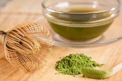 Powdered green tea and a cup Royalty Free Stock Image