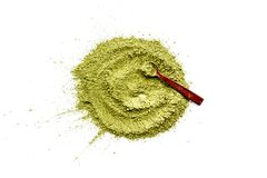 Powdered matcha green tea scattered on white background top view copy space. Powdered matcha green tea scattered on white background top view Stock Images
