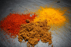 Powdered spices. Scattered on a black board Stock Image
