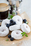 Powdered sugar donuts on parchment Stock Photos