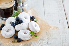 Powdered sugar donuts on parchment Stock Photo