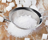 Powdered sugar in a metal sieve Stock Photo