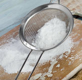 Powdered sugar in a metal sieve Stock Image