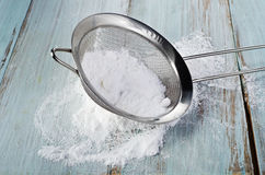 Powdered sugar in a metal sieve Royalty Free Stock Photography