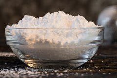 Powdered Sugar and Shaker. Powdered Sugar in an ingredient bowl royalty free stock photography
