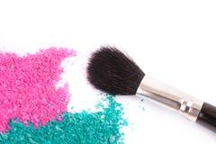 Powdery eyeshadow makeup and brush Royalty Free Stock Image