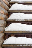 Powdery snow covered old wooden stairs. Royalty Free Stock Photos