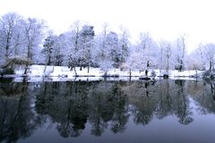 Powdery soft snow across an icy lake Stock Photos