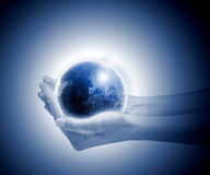 Power. Human hands holding glowing green planet Royalty Free Stock Photography