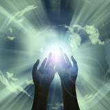 Power of. Hands reveal light in sky Stock Photography