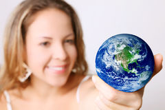 Power. Woman with the world in her hands Royalty Free Stock Images