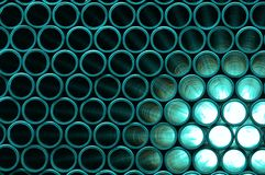 Power. Rows of Pipes creating a Pattern, Stacked, Radiation, Energy Production of Power Royalty Free Stock Photo