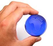 Power. A man's hand holding a glass globe royalty free stock images