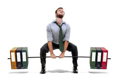 Power. Muscular businessman lifting weights made of heavy files Stock Images