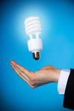 Power. A hand with a floating light bulb stock image