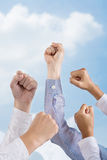 Power. Cropped image of human fists in the air in the sign of power over the sky Royalty Free Stock Photos