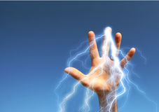 Power !. Hand with electricity on blue sky with copyspace Royalty Free Stock Image