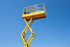 Power acces platform. Yellow platform to work in inaccessible places Stock Photography