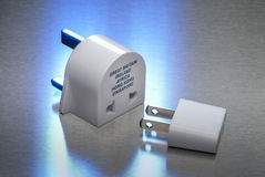 Power adapters between USA and Great Britain Royalty Free Stock Photo