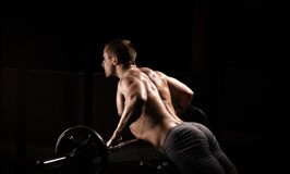 Power athletic guy , execute exercise with dumbbells Stock Photos
