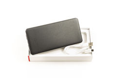 Power bank for charging mobile devices. Gray power bank, small device electricity to recharge of smart phone via USB Royalty Free Stock Photo