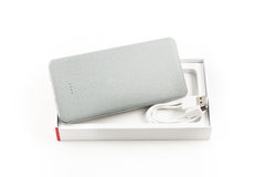 Power bank for charging mobile devices. Small device electricity to recharge of smart phone via USB Stock Photo