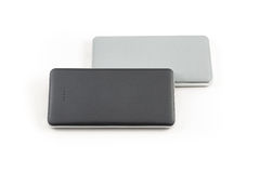 Power bank for charging mobile devices. Small device electricity to recharge of smart phone via USB Stock Photography
