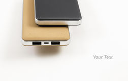 Power bank for charging mobile devices. Small device electricity to recharge of smart phone via USB Royalty Free Stock Photos