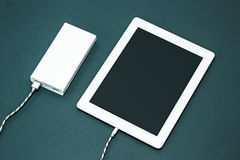 Power bank and laptop Royalty Free Stock Photo