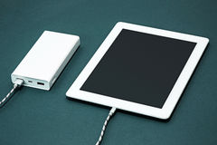 Power bank and laptop Royalty Free Stock Image