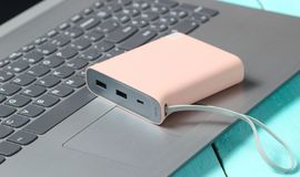 Power bank on the laptop keyboard. External battery. royalty free stock images