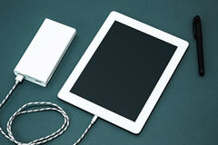 Power bank and laptop Royalty Free Stock Photography