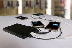 Power bank rechargeable batteries attached to a mobile phone Royalty Free Stock Images