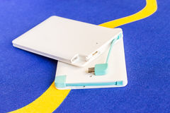 Power bank small mini size on blue background Royalty Free Stock Photo