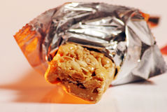 Power bar. Isolated image granola bar in foil wrapper Royalty Free Stock Photos