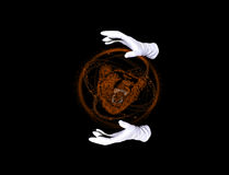 The power of the Beast. Beast within orange sphere and hands in white gloves making passes above it Stock Photo