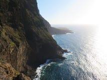 Volcanic escarpment on the sea. Royalty Free Stock Images