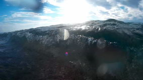 Power and beauty of sea waves. Sea waves splashed the sandy beach,camera in an underwater casing video clip stock video